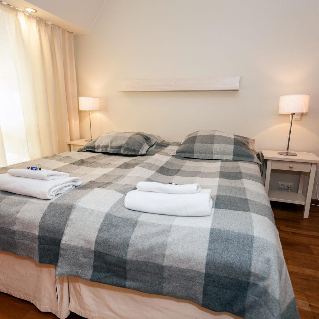 Hotel K5 Standard-sviitin makuuhuone.